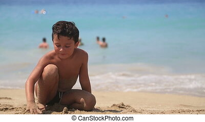 Cute boy on the beach