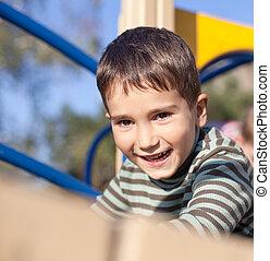 Cute boy on the playground