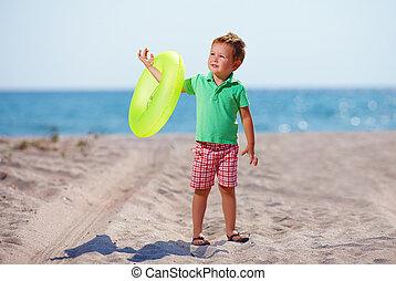 cute boy on the summer beach