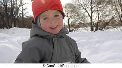 Cute boy park winter close up - Cute baby walking outdoors...