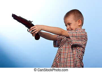Cute boy playing with the gun