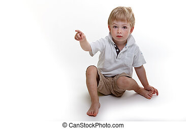 Cute boy pointing at you!