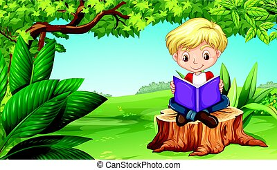 Cute boy reading book in park