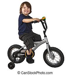 Cute boy riding bicycle