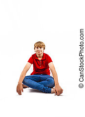 cute boy sitting on the floor