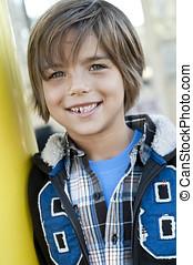 Cute boy - outdoor portrait of cute 7 yr old boy, jacket...