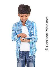 Cute boy using his tablet pc