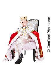 Cute boy wearing costume of a king