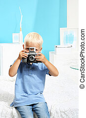 Cute boy with a camera
