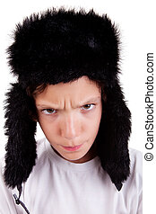 cute boy with a cap, angry, isolated on white background, studio shot.