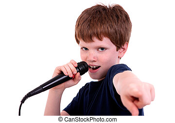 Cute boy with a microphone sings isolated on white, studio shot