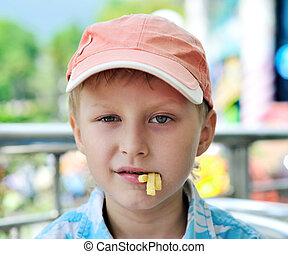 cute boy with french fries