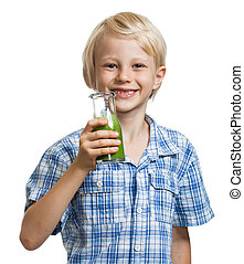 Cute boy with green smoothie oro juice - Happy cute boy with...