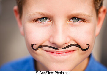 Cute boy with painted mustache - Portrait of a cute little...