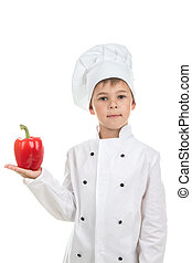 Cute boy with pepper in Chef uniform on white background