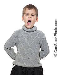 Cute boy yawning isolated on a white background