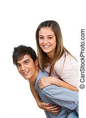 Cute boyfriend piggybacking his girlfriend.