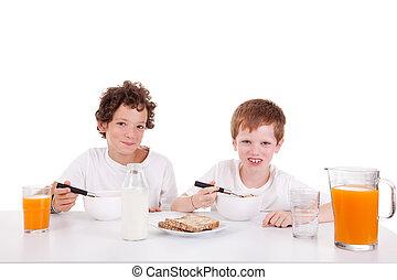 cute boys taking breakfast, isolated on white, studio shot
