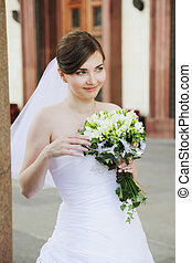 Cute bride with flowers