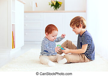 cute brother playing together at home