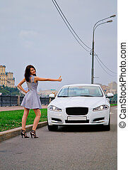 Cute brunette and luxury car