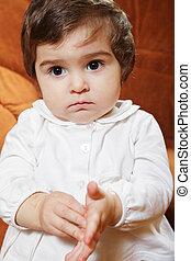 Cute brunette baby girl