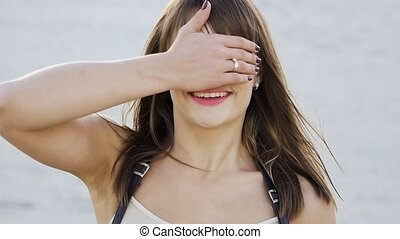 cute brunette closes eyes with her hand in slow motion
