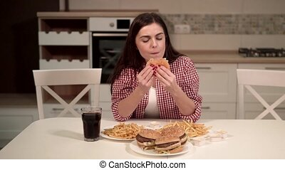 Cute Brunette Enjoys Hamburger