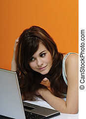 cute brunette girl using laptop