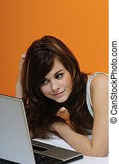 cute brunette girl using laptop
