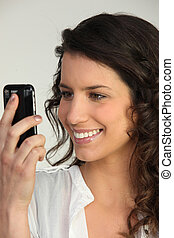 cute brunette happy to receive sms