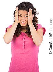 Cute brunette having headache
