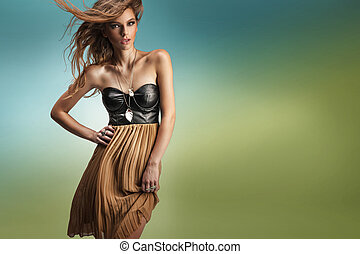 Cute brunette in a fashion pose