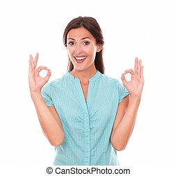 Cute brunette in blue blouse gesturing a great job