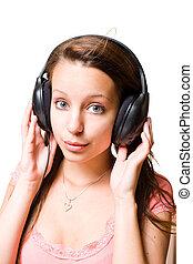 Cute brunette in headphones