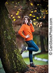 Cute brunette teen girl in park