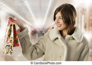 cute brunette with christmas purchase