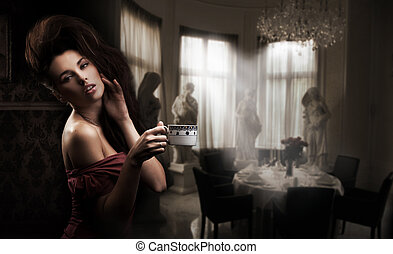 Cute brunette with cup of coffee