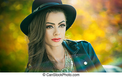 Cute brunette with hat in fall