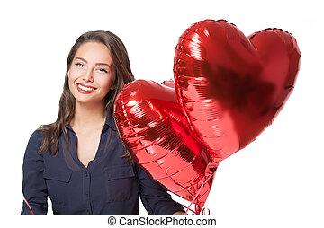 Cute brunette with heart ballons.