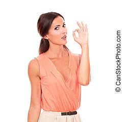 Cute brunette woman gesturing a great job