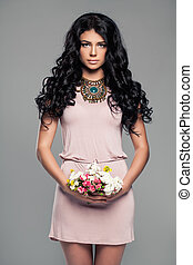 Cute Brunette Woman in Summer Style Dress and Flowers