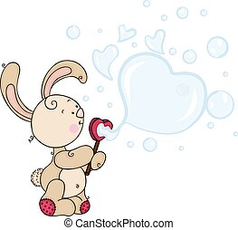Cute bunny blowing soap bubbles