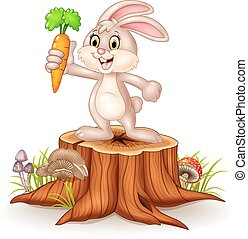 Cute bunny holding carrot on stump