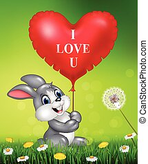 Cute bunny holding red heart balloons on green grass