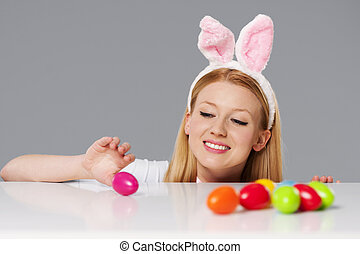 Cute bunny woman with easter eggs