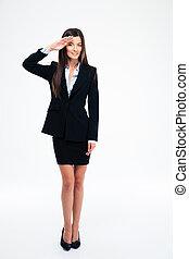 Cute businesswoman saluting