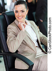 cute businesswoman sitting in office