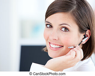 Cute businesswoman talking with clients in front of her ...