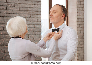 Cute careful aging dance couple performing in the dance studio